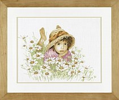 Little girl in a field of flowers